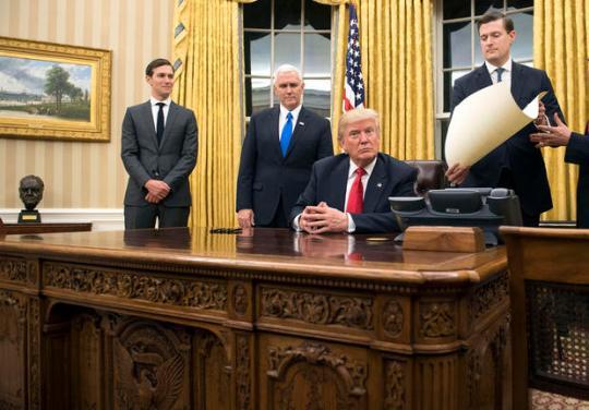 President Donald Trump prepares to sign a confirmation for Defense Secretary James Mattis